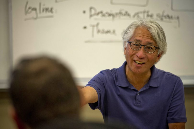 Shawn Wong teaches story concept and writing to students of the Red Badge Project.